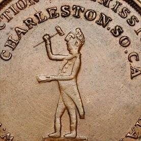 coin with a person holding a gavel