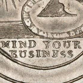 coin with the words mind your business on it